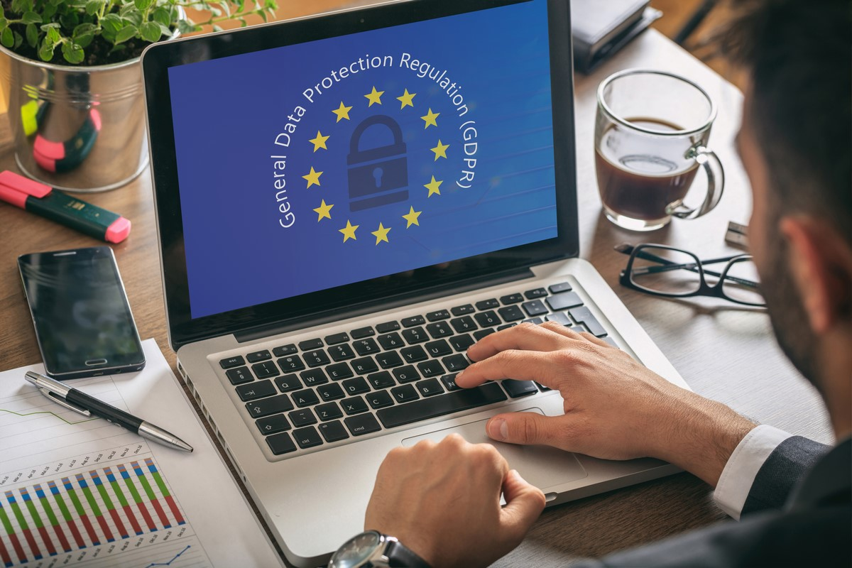 Newman HR UK employment law advice laptop screen with GDPR EU graphic